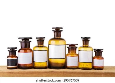 vintage pharmacy bottles on wooden board