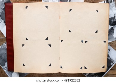 Vintage photo album with blank pages on the background of the photos