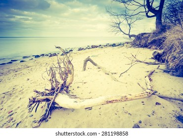 Vintage photo of beautiful long exposure landscape of rocky sea shore. Tranquil scene of Baltic sea near Gdynia in Poland.