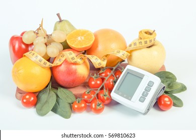 Vintage photo, Blood pressure monitor, fresh fruits with vegetables and tape measure, healthy lifestyle, slimming and prevention of hypertension concept
