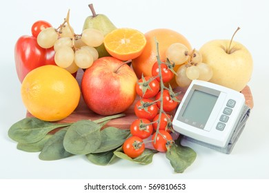 Vintage photo, Blood pressure monitor and fresh fruits with vegetables, healthy lifestyle and prevention of hypertension concept