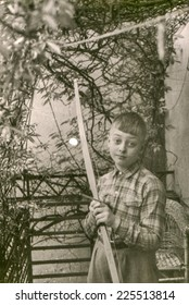 Vintage photo of boy with a bow, fifties
