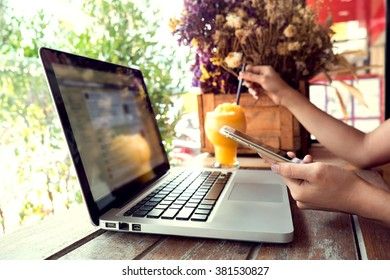 Vintage photo of Business woman using smartphone at co-working work table.