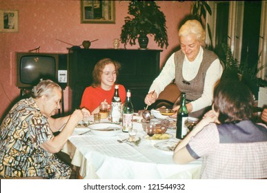 Vintage photo of Christmas eve family dinner (early seventies)