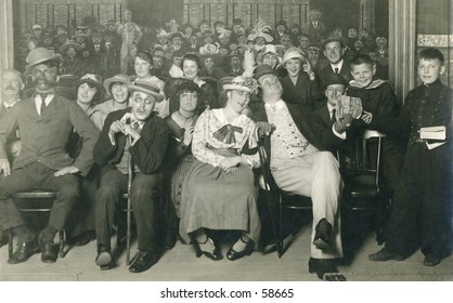 Vintage photo, circa 1900 of an audience attending a theatrical performance