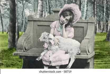 Vintage photo, circa 1900, of Little Bo Peep holding a lamb