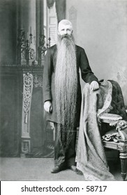 Vintage photo, circa 1900, of a man with a very long beard