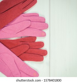 Vintage photo, Colorful woolen gloves for woman on white boards, warm clothing for autumn or winter, copy space for text