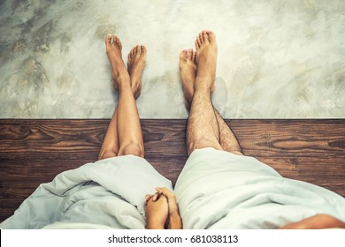 Vintage photo of Couple acting naughty in bed , Couple's feet in bed