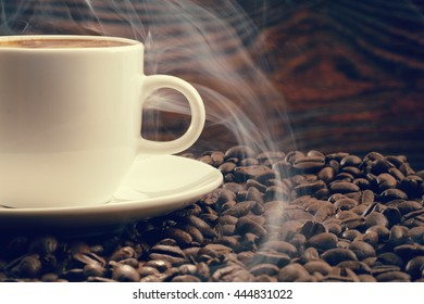 Vintage photo of cup and coffee with roasted coffee