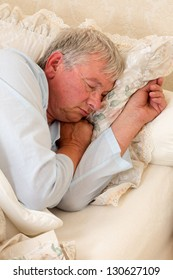 Vintage photo of an elderly man sleeping