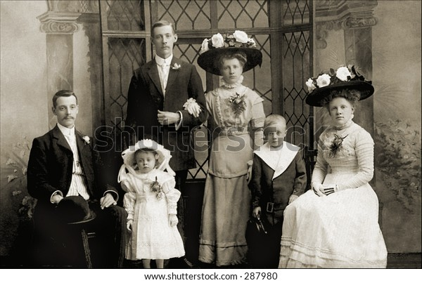 Vintage photo of a Family Portrait In Sunday Best