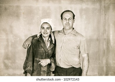 Vintage photo of father and daughter in work clothes (sixties)