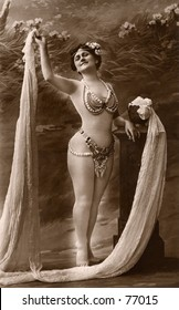 Vintage photo of female performer in costume, circa 1900