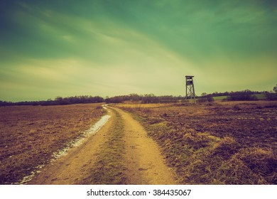 Vintage photo of field with raised hide. Filtered look landscape