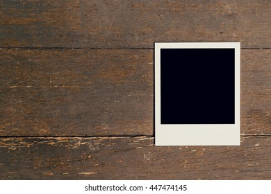 Vintage photo frame blank on old wood background with space
