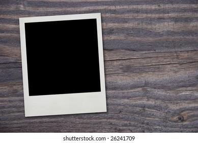 vintage photo frame on wood background