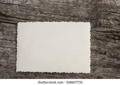 vintage photo frame on wooden board background