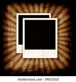 Vintage photo frames on grunge wall with sunburst