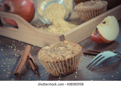 Vintage photo, Fresh muffins with millet groats, oatmeal flakes, cinnamon and apple baked with wholemeal flour, concept of delicious, healthy dessert or snack