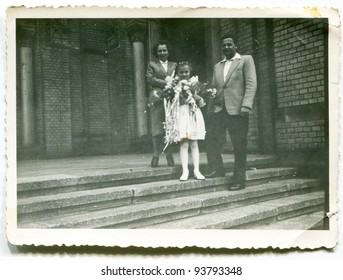 Vintage photo of girl with parents - First Communion (fifties)