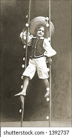 Vintage photo of a Girl Performing On Stilts