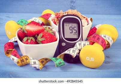 Vintage photo, Glucose meter with sugar level, healthy food, dumbbells for fitness and tape measure, concept of diabetes, slimming, healthy lifestyle