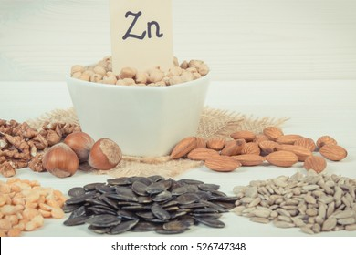 Vintage photo, Inscription Zn, Ingredients or products containing zinc and dietary fiber on white board, natural sources of minerals, healthy lifestyle and nutrition