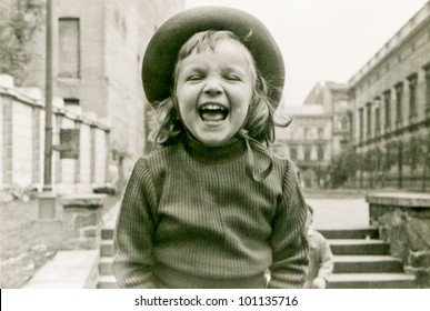 Vintage photo of little girl laughing (fifties)