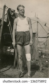 Vintage photo of man with an antiseptic dressing on his knee, 1952
