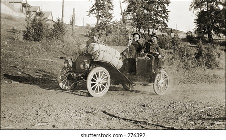 Vintage Photo of a Man And Woman Driving Old Car