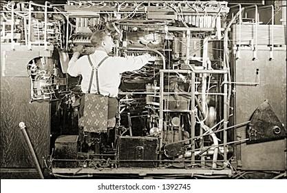 Vintage photo of a Man Working On Complex Machine