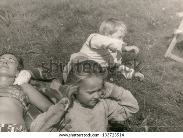 Vintage photo of mother and children (seventies)