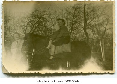Vintage photo of mother and daughter riding a horse (fifties)