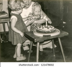 Vintage photo of mother and little children - first birthday of baby boy - 1983