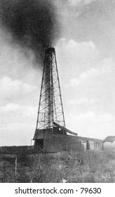 Vintage photo of oil derrick gushing oil