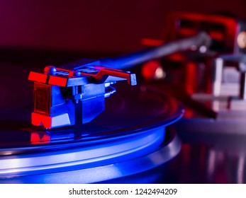 Vintage photo of Old Gramophone, playing a music. Neon light. Cinemagraph, retro record vinyl player. Record on turntable. Top view close up. Loop-able