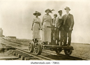 Vintage photo of people on a railroad handcart
