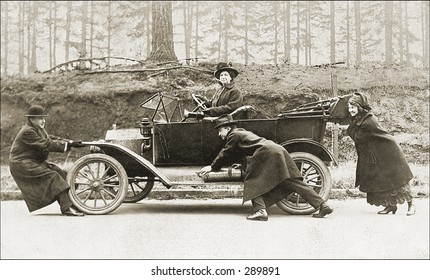 Vintage Photo of People Pushing Old Car