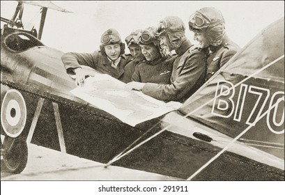 Vintage photo of a Pilots Poring Over Flight Plan