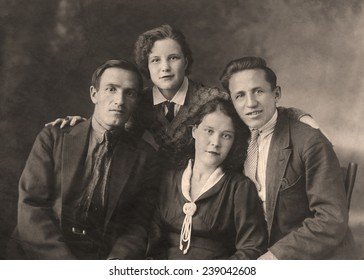 A vintage photo portrait from 1954 of Russian family.