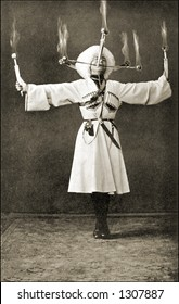 Vintage photo of a Russian Performer Doing Flaming Balancing Act