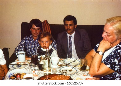 Vintage photo (scanned reversal film) - family dinner, early eighties