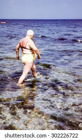 Vintage photo (scanned reversal film) of overweight woman bathing in sea, early 1970's