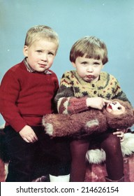 Vintage photo of sister and brother, eighties