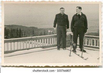 Vintage photo of skier with friend (fifties)
