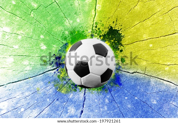 Vintage photo of soccer ball and the colors of the Brazil flag