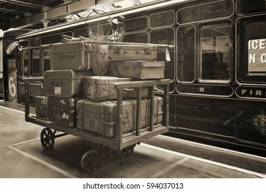 Vintage photo of suitcases next to the old steam train (locomotive)