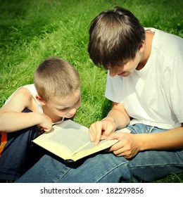 Vintage photo of The Teenager reads the Book to the Child