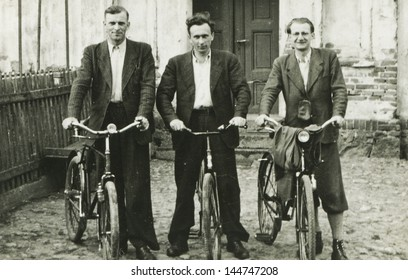 Vintage photo of three men with bicycles, forties